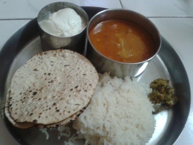 Fresh curd,Pepper Papad roasted,Steamy Hot rice and green chillipickle,with the Puli Kulambu